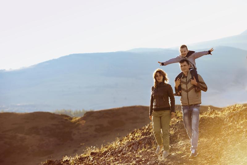family hiking on a mountain