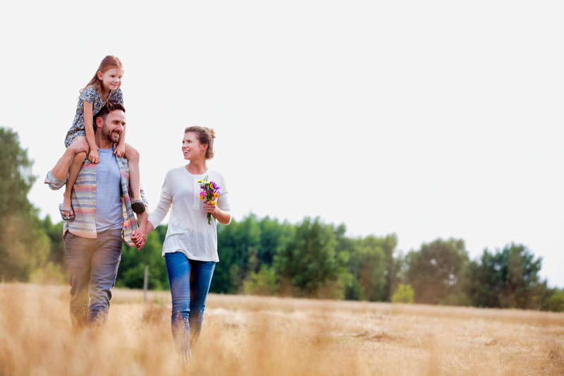 family walking in a field of crops
